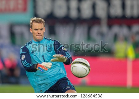 VIENNA,  AUSTRIA - SEPTEMBER 11 Manuel Neuer (#1 Germany) catches the ball during the WC qualifier soccer game on September 11, 2012 in Vienna, Austria. - stock photo