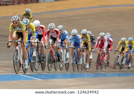 VIENNA,  AUSTRIA - SEPTEMBER 27  Ondrej Rybin (Czech Republic) leads the peloton in the men's U23 point race of an indoor cycling meeting on September 27, 2012 in Vienna, Austria. - stock photo