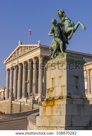 VIENNA, AUSTRIA - SEPTEMBER 2003: Parliament building, in Greek revival architecture style. Bronze Horse Tamer sculpture (1901) by Josef Lax.