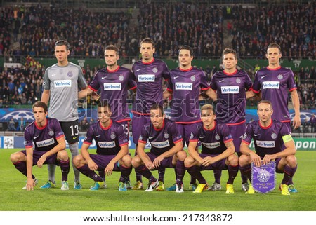 VIENNA, AUSTRIA - SEPTEMBER 18 The team of FK Austria Wien pose before a UEFA Champions League game on September 18, 2013 in Vienna, Austria. - stock photo