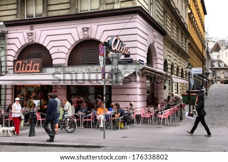 VIENNA, AUSTRIA - SEPTEMBER 7, 2011: Tourists stroll in the Old Town of Vienna. As of 2008, Vienna was the 20th most visited city worldwide (by international visitors). - stock photo