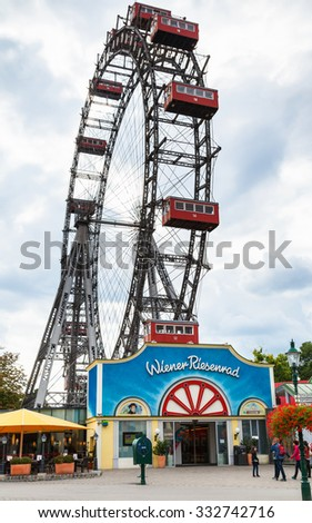 VIENNA, AUSTRIA - SEPTEMBER 30, 2015: Wiener Riesenrad (Vienna Giant Whee) in Prater park. It is a 64,75-metre tall Ferris wheel at the entrance of the Prater, it was constructed in 1897