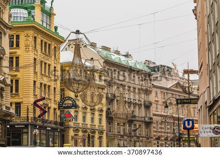 VIENNA, AUSTRIA - 5TH JANUARY 2016: A view along the Graben in Vienna in the winter. Snow can be seen on the roof and Christmas decorations can be seen. - stock photo