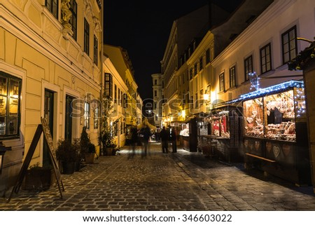 VIENNA, AUSTRIA - 24TH NOVEMBER 2015: A view along Spittelberg market, Spittelberggasse at night during the Christmas season. People and stalls can be seen. - stock photo