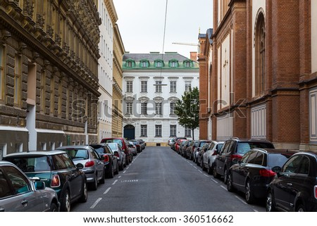 VIENNA, AUSTRIA - 20TH SEPTEMBER 2015: The outside of buildings in Vienna during the day. Lots of parked cars can be seen. - stock photo