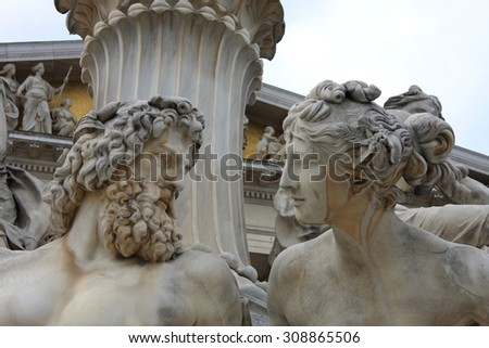 vienna, austrian parliament and sculpture of mythological beings - stock photo