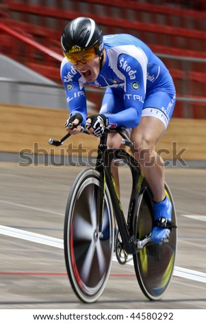 VIENNA - JANUARY 11:Indoor track cycling meeting - Francesco Ceci (Italy) places second in the men's time trial on January 11, 2010 in Vienna, Austria. - stock photo