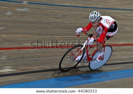 VIENNA - JANUARY 12: Indoor track cycling meeting - Stefan Matzner (Austria) places seventeenth in the junior's point race on January 12, 2010 in Vienna, Austria. - stock photo