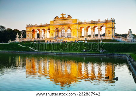 VIENNA - OCTOBER 19: Gloriette Schonbrunn at sunset on October 19, 2014 in Vienna. It's the largest gloriette in Vienna built in 1775 as the last building constructed in the Schonbrunn garden. - stock photo