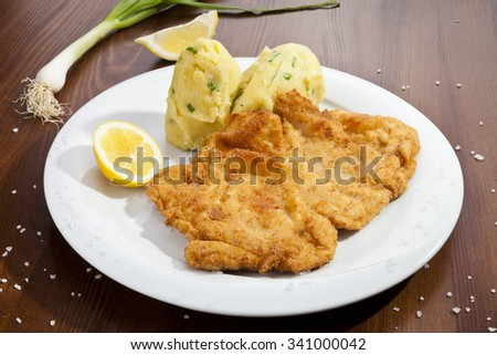 Vienna schnitzel with potato mash potatoes - stock photo