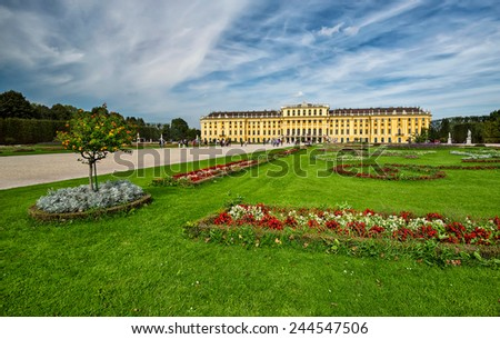 VIENNA-SEPTEMBER 18: Tourists visits Schonbrunn Palace Gardens on September 18, 2014 in Vienna. Palace and Gardens of Schonbrunn are a famous UNESCO World Heritage Site. - stock photo