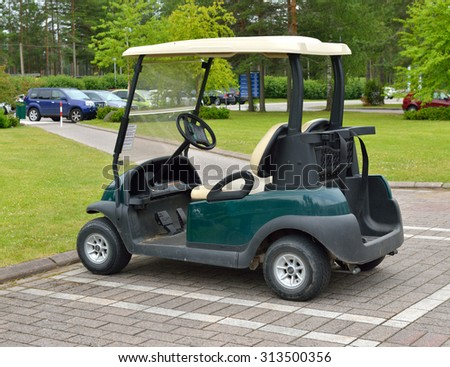 VIERUMAKI, FINLAND - JULY 18,2015:Vierumaki has two 18-hole golf courses, Classic and Cooke, as well as 9-hole par-3 Coach course. Golf carts waiting for use it on golf course