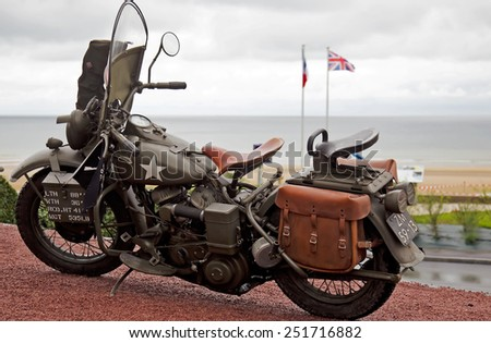 VIERVILLE, FRANCE - JUNE 4: A WW2 US army Harley motorcycle is put on static display along the seafront at Omaha beach as part of the 70th D-Day anniversary celebrations on June 4, 2014 in Vierville - stock photo