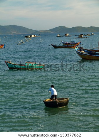 Vietnam boat, Nutshells in sunset - stock photo