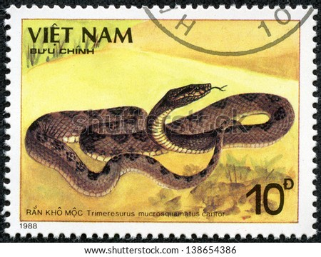 VIETNAM - CIRCA 1988: A stamp printed in VIETNAM shows a Trimeresurus mucrosquamatus cantor, series, circa 1988 - stock photo