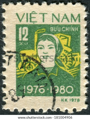 VIETNAM - CIRCA 1979: Postage stamp printed in Vietnam, shows Peasant woman, tractor, circa 1979 - stock photo