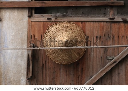 Vietnam conical hat hanging on a wall.