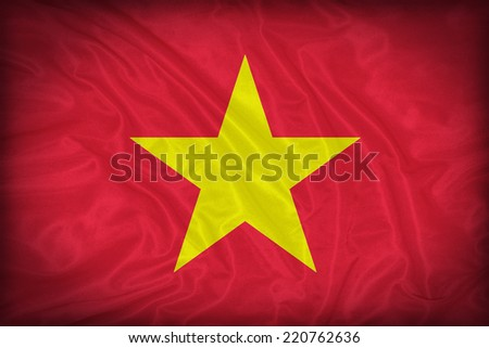 Vietnam flag pattern on the fabric texture ,vintage style - stock photo