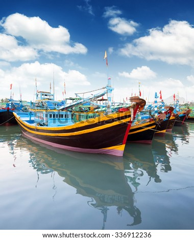 Vietnam, Phan Thiet, Mui Ne - fishing boats in harbor. - stock photo