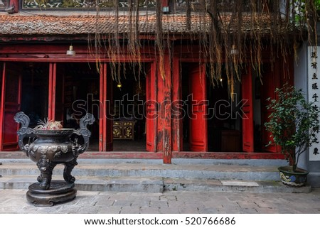 Vietnam traditional style red door with a copper incensory