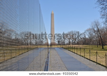 Vietnam War Memorial with Washington Monument in Background - stock photo