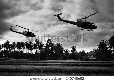 Vietnam War 'style' B&W image circa 1968 of two helicopters flying low over the rice paddies of South Vietnam looking for Viet Cong insurgents during the Tet Offensive in 1968. (Artist's Impression) - stock photo
