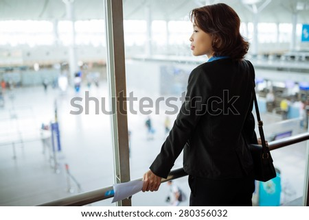 Vietnamese business lady at the airport waiting for flight - stock photo