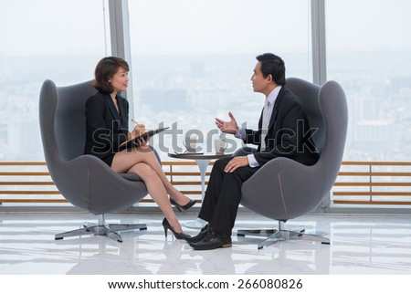 Vietnamese business people having meeting in the modern office - stock photo