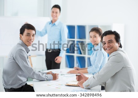 Vietnamese business team having meeting in the office - stock photo