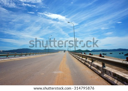 Vietnamese country road, cross sand hill, jungle or mountain, route for travel, discovery Vietanam, landscape of rural under blue sky on day - stock photo