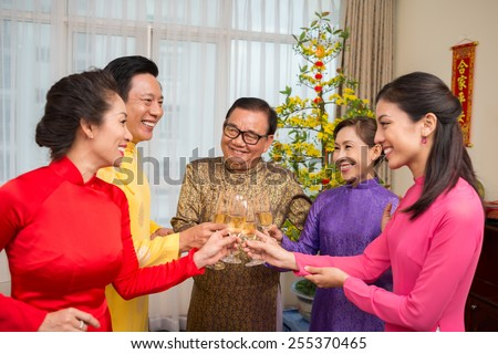 Vietnamese family clinking glasses celebrate new stock photo vietnamese family clinking glasses to celebrate new year m4hsunfo Choice Image