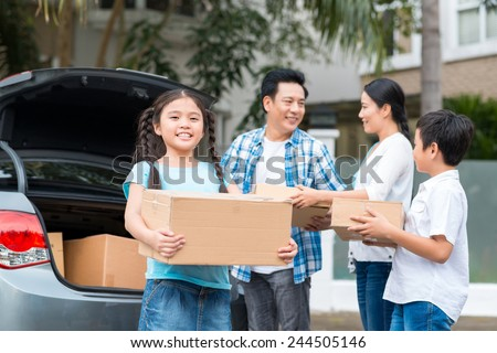 Vietnamese family moving to the new house - stock photo
