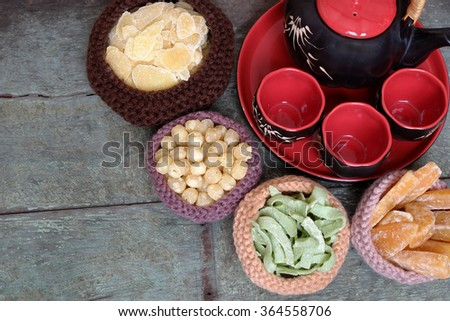 Vietnamese food for Tet holiday in spring, jam is traditional food on lunar new year, can make from sweet potato, lotus seed, ginger with sugar, colorful background for Vietnam custom