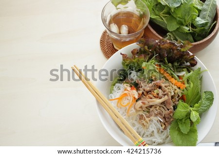 Vietnamese food, Rice noodle and grilled pork with tea - stock photo