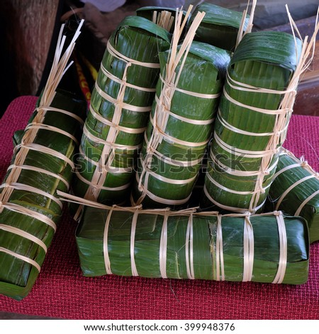Vietnamese food, traditional food on tet holiday in spring, banh tet also name Cylindric glutinous rice cake, make from sticky rice, mung been, cover by banana leaf, tradition eating on lunar new year