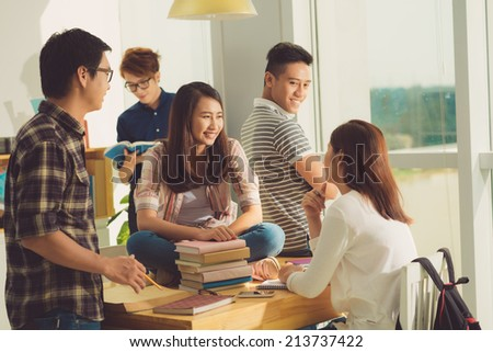 Vietnamese high school students in classroom talking during the break - stock photo
