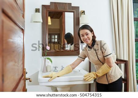 Vietnamese Maid Cleaning Sink Bathroom Suite Stock Photo Royalty - Bathroom maid