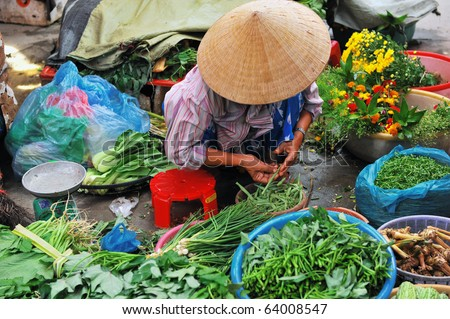Vietnamese saleswoman at the market - stock photo