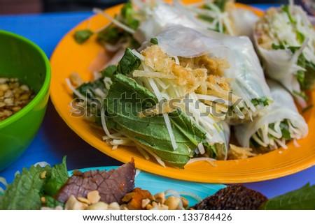Vietnamese street food, fresh vegetable with crispy duck skin - stock photo