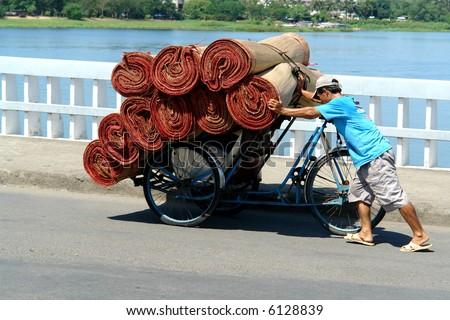 vietnamese street life in the capital of vietnam hanoi - stock photo