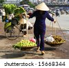 Vietnamese street vendor in Hanoi - stock photo
