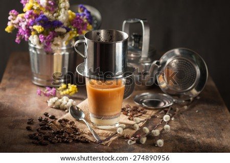 Vietnamese style drip coffee with condense milk, with low key scene - stock photo