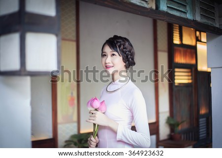 Vietnamese traditional clothes at pagoda , Chinese happy new year , spring - stock photo