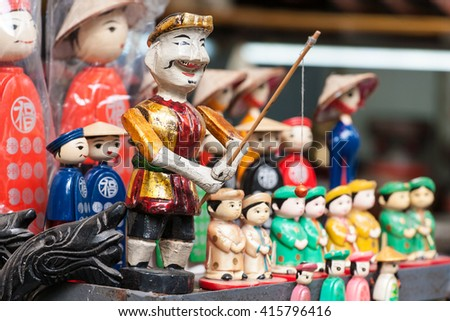 Vietnamese water puppets for its famous water puppet theater on shop in Hanoi's Old Quarter - stock photo