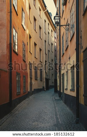 View a narrow street in the Old Town. Stockholm, Sweden. Retro film effect.