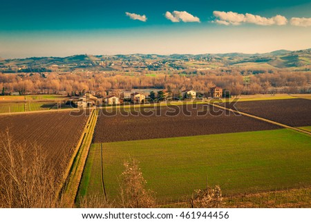 View above the fields and villages in Emilia-Romagna region, Italy.