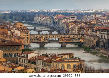 View above the roofs of Florence with river Arno and Ponte Vecchio on the right side.