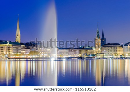 View across the Inner Alster Lake (Binnenalster) in Hamburg, Germany with the City Hall, the Nikolai and the Peter church - stock photo