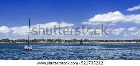 View across the Pumicestone Passage of the beautiful low line Bribie Island, Australia