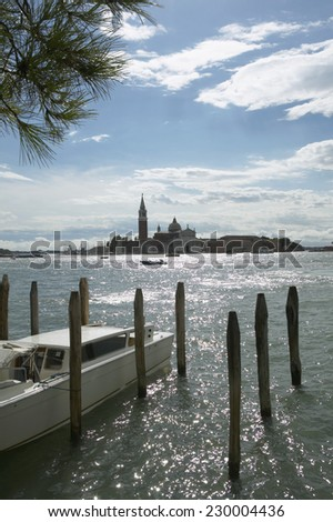 View across the waters of Venice harbour with the San Giorgio Monastery in the background, Venice, Italy - stock photo